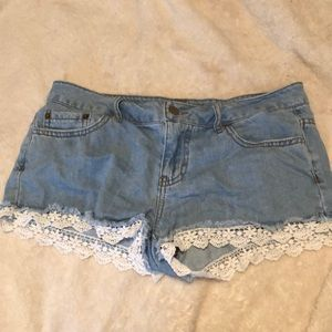 Forever 21 blue jean shorts with white lace trim